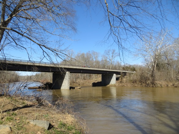 The bridge over the Rappahannock River with three randonneurs crossing.