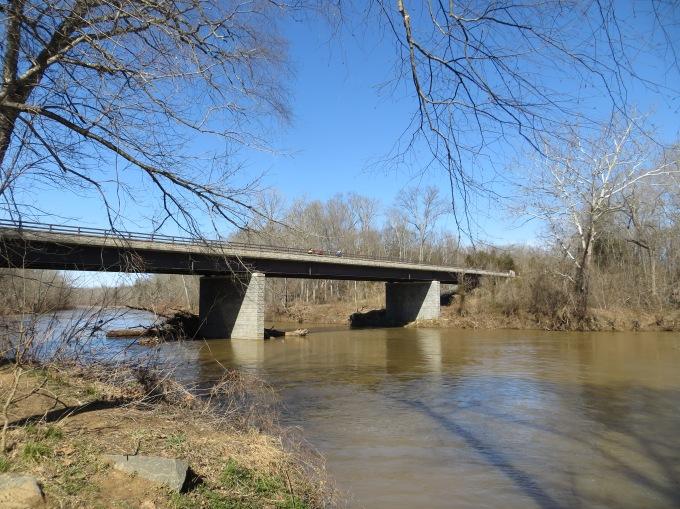 The bridge over the Rappahannock River with three randonneurs crossing.