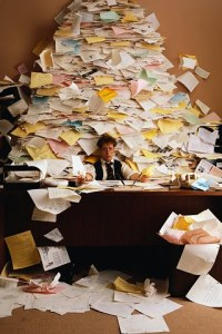 Businessman Buried in Paperwork