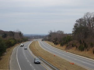Storm clouds gather over Route 234 and the Lucasville Road overpass.  The Appalachians are in the background.
